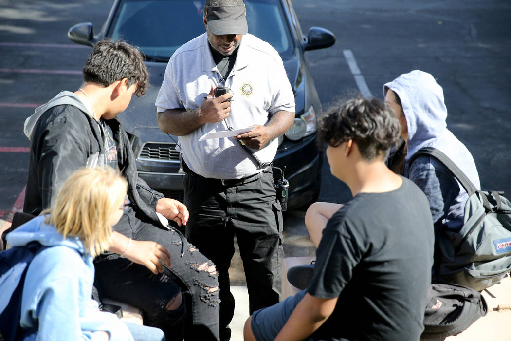 Clark County School District Attendance Officer Tony Stark talks to unidentified truant students at Sterling Park Apartments in Las Vegas Monday, Oct. 17, 2018. K.M. Cannon Las Vegas Review-Journa ...