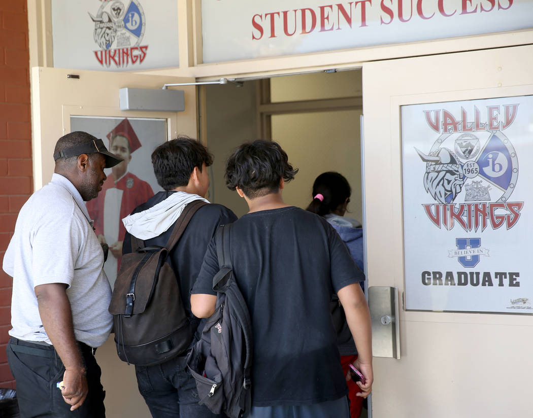 Clark County School District Attendance Officer Tony Stark returns unidentified truant students to Valley High School in Las Vegas Monday, Oct. 17, 2018. K.M. Cannon Las Vegas Review-Journal @KMCa ...