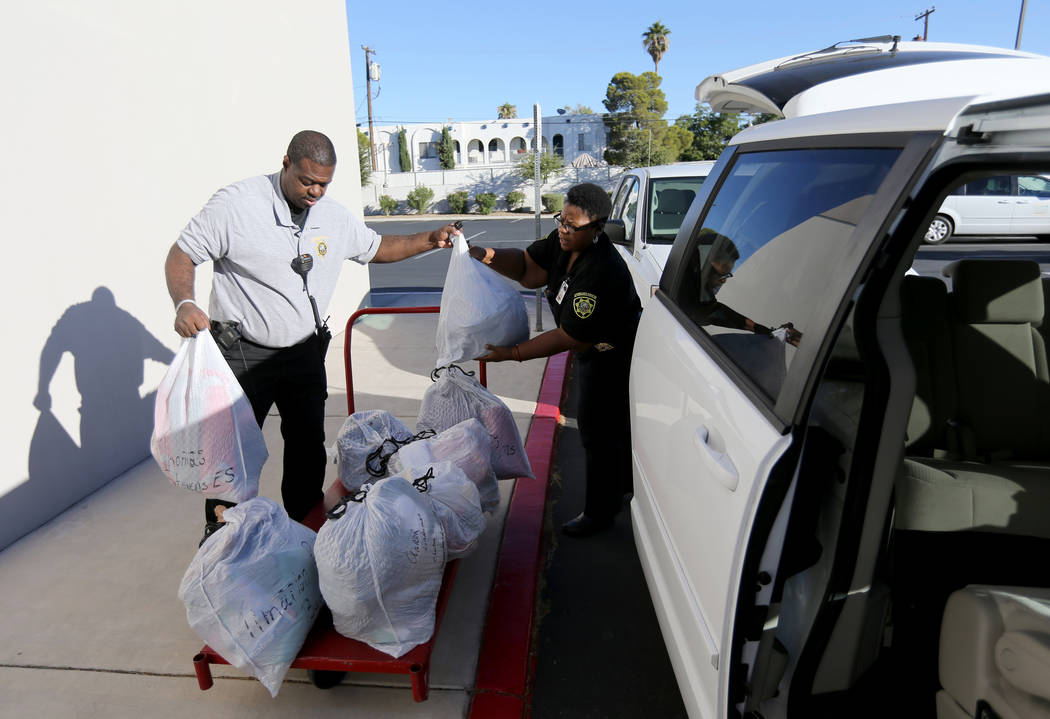 Clark County School District Attendance Officers Tony Stark and Gwendolyn Godfrey load clothes from the nonprofit Operation School Bell in Las Vegas to be delivered to schools with children in nee ...