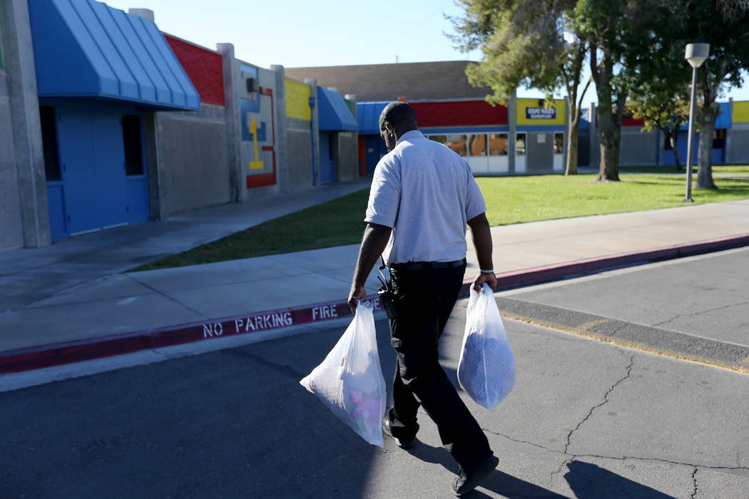 Clark County School District Attendance Officer Tony Stark delivers donated clothing to Gene Ward Elementary School in Las Vegas Tuesday, Oct. 18, 2018. K.M. Cannon Las Vegas Review-Journal @KMCan ...