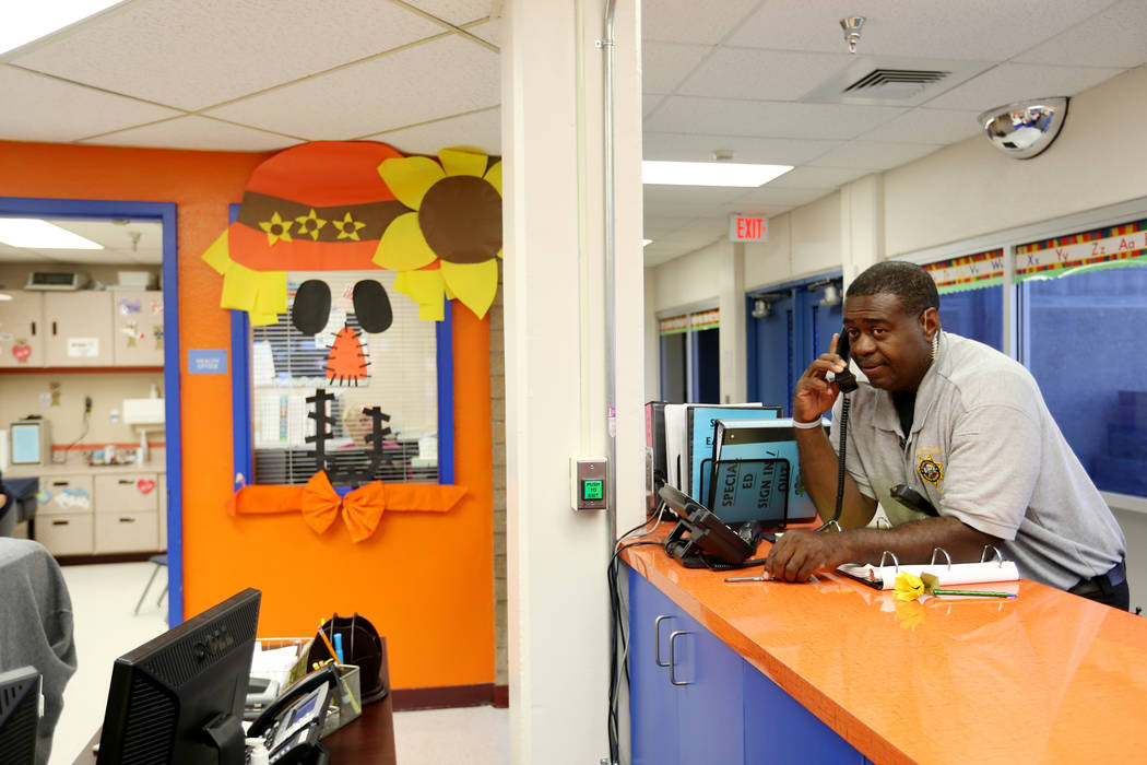 Clark County School District Attendance Officer Tony Stark checks in with his office at Gene Ward Elementary School in Las Vegas Tuesday, Oct. 18, 2018. K.M. Cannon Las Vegas Review-Journal @KMCan ...