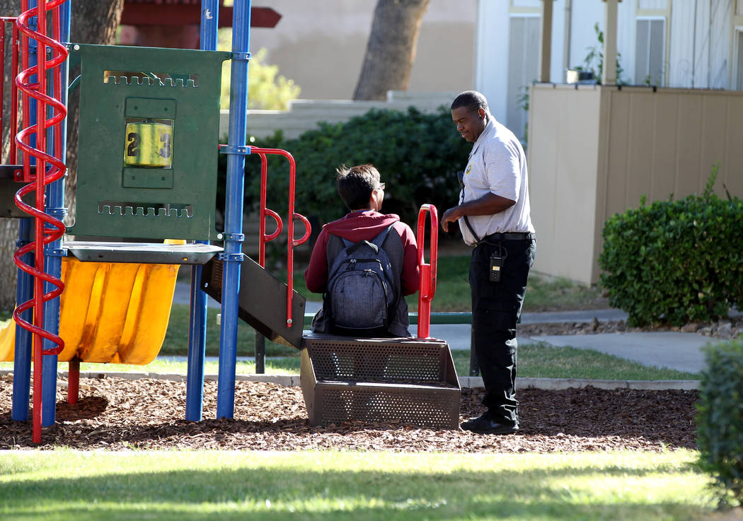 Clark County School District Attendance Enforcement Officer Tony Stark checks on a student at Canyon Club Apartments in Las Vegas Tuesday, Oct. 18, 2018. The student was a senior who was home earl ...