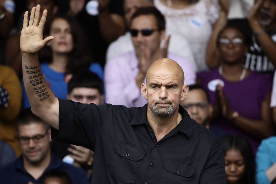 In this Sept. 21, 2018 photo Braddock, Pa., Mayor John Fetterman speaks at a campaign rally for Pennsylvania candidates in Philadelphia. Fetterman, Pennsylvania's newly elected lieutenant governor ...