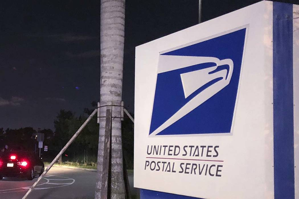 The U.S. Postal Service has been fined by federal safety officials after a Las Vegas mail carrier was hospitalized for heat exposure. (Josh Replogle/AP)