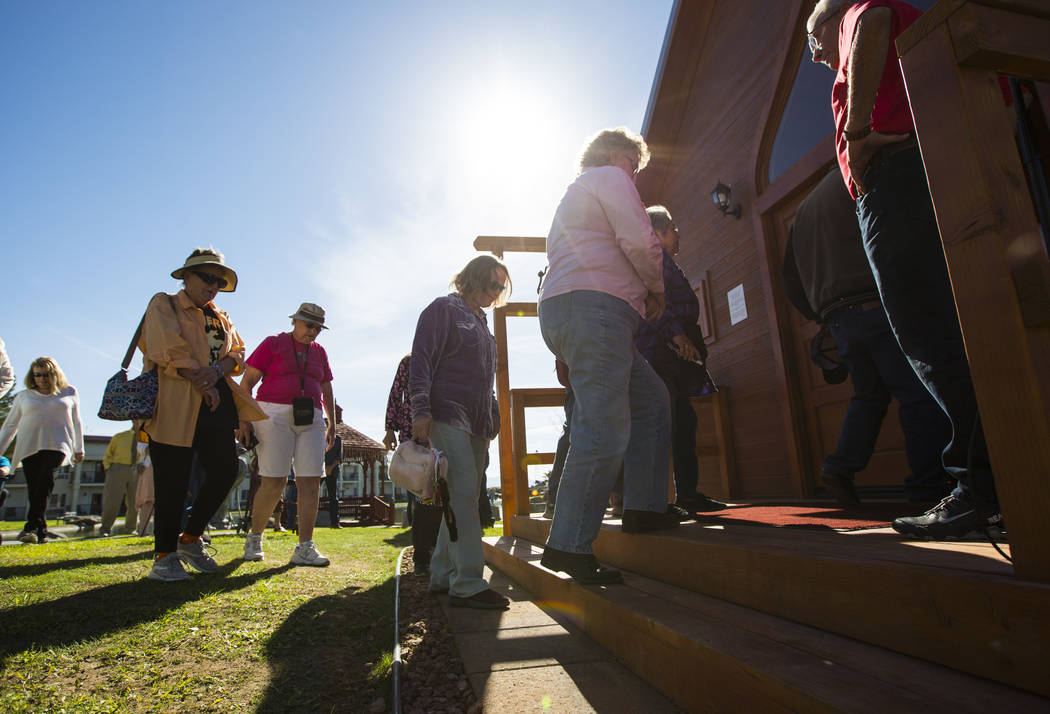 People arrive for the opening of the Chapel at Longstreet, a replica of a Catholic church in Belmont, at Marsh's Longstreet Casino in Amargosa Valley on Sunday, Oct. 28, 2018. Chase Stevens Las Ve ...