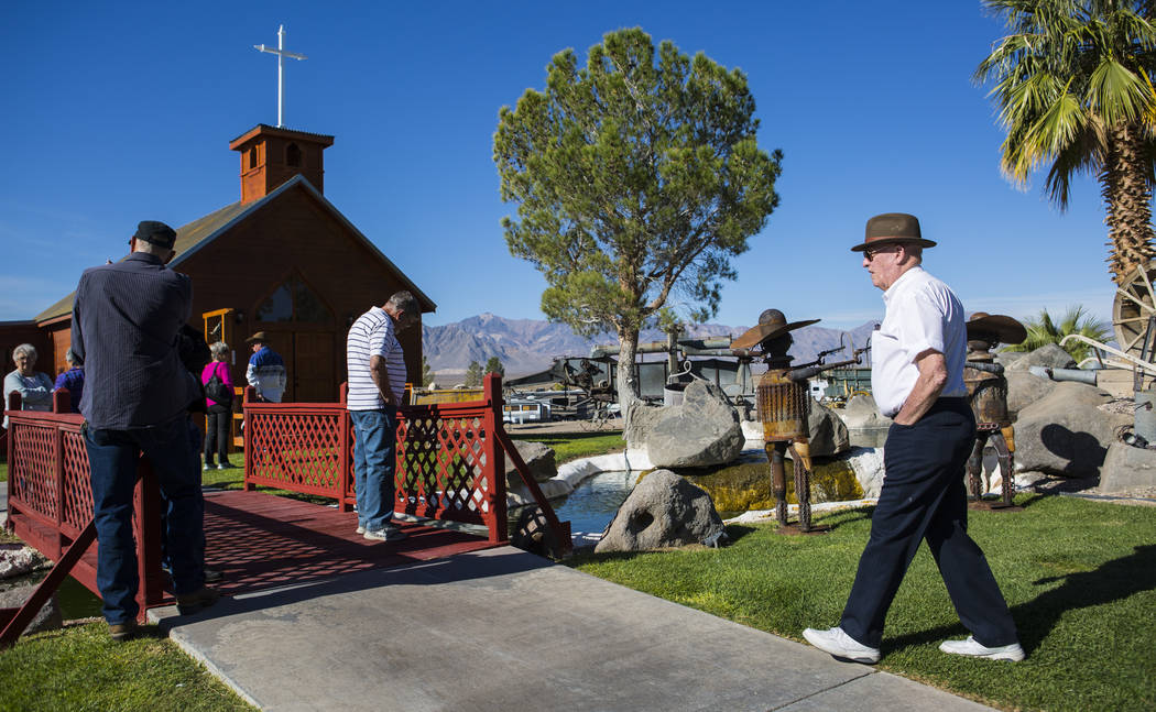 Businessman Jim Marsh, right, arrives for the opening of the Chapel at Longstreet, a replica of a Catholic church in Belmont, at Marsh's Longstreet Casino in Amargosa Valley on Sunday, Oct. 28, 20 ...