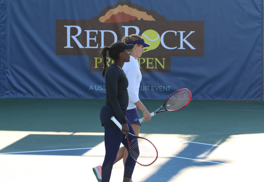 Asia Muhammad, front, and Maria Sanchez leave the court after winning against Manon Arcangioli and Sherazad Reix of France during their doubles match at the Red Rock Pro Open tennis tournament at ...
