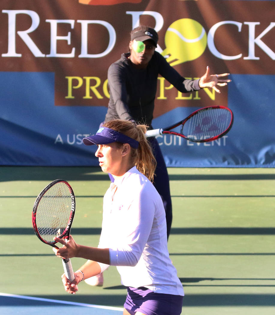 Asia Muhammad, back, returns the ball as her partner Maria Sanchez looks on as they face Manon Arcangioli and Sherazad Reix of France during their doubles match at the Red Rock Pro Open tennis tou ...
