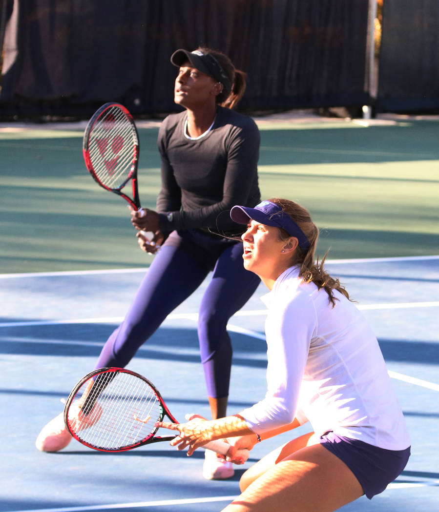 Asia Muhammad, left, and Maria Sanchez keep their eyes on the ball as they face Manon Arcangioli and Sherazad Reix of France during their doubles match at the Red Rock Pro Open tennis tournament a ...