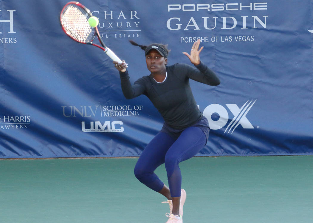 Asia Muhammad returns the ball as she and her partner Maria Sanchez face Manon Arcangioli and Sherazad Reix of France during their doubles match at the Red Rock Pro Open tennis tournament at Red R ...