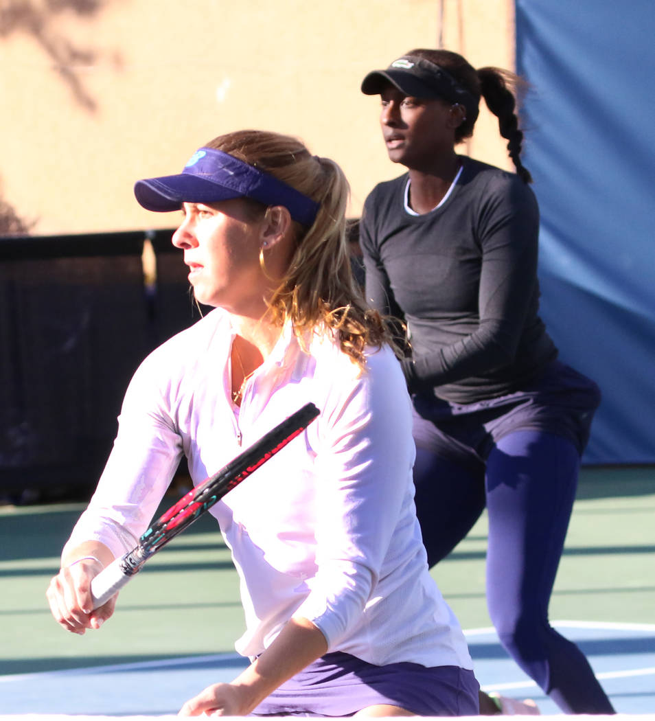 Asia Muhammad, back, and Maria Sanchez keep their eyes on the ball as they face Manon Arcangioli and Sherazad Reix of France during their doubles match at the Red Rock Pro Open tennis tournament a ...