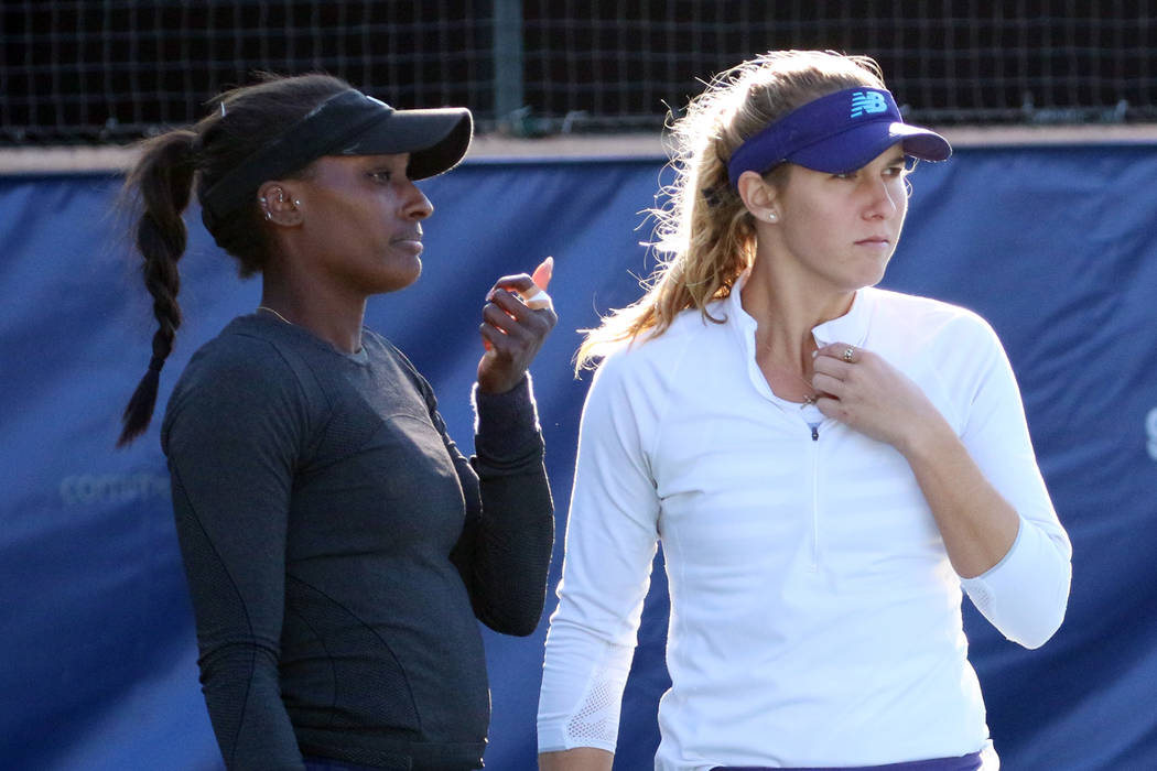 Asia Muhammad, left, and Maria Sanchez discuss as they face Manon Arcangioli and Sherazad Reix of France during their doubles match at the Red Rock Pro Open tennis tournament at Red Rock Country C ...