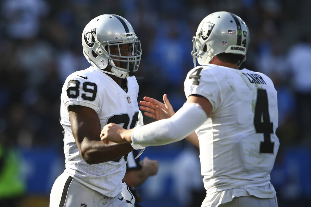 Oakland Raiders wide receiver Amari Cooper (89) celebrates his touchdown with quarterback Derek Carr (4) during an NFL game against the Los Angeles Chargers at StubHub Center in Carson, Calif. on ...