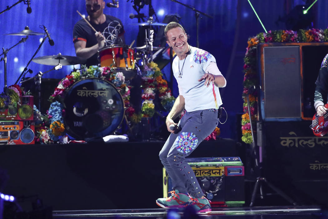 Chris Martin of Coldplay performs at the 2017 iHeartRadio Music Festival Day 1 held at T-Mobile Arena on Friday, Sept. 22, 2017, in Las Vegas. (Photo by John Salangsang/Invision/AP)