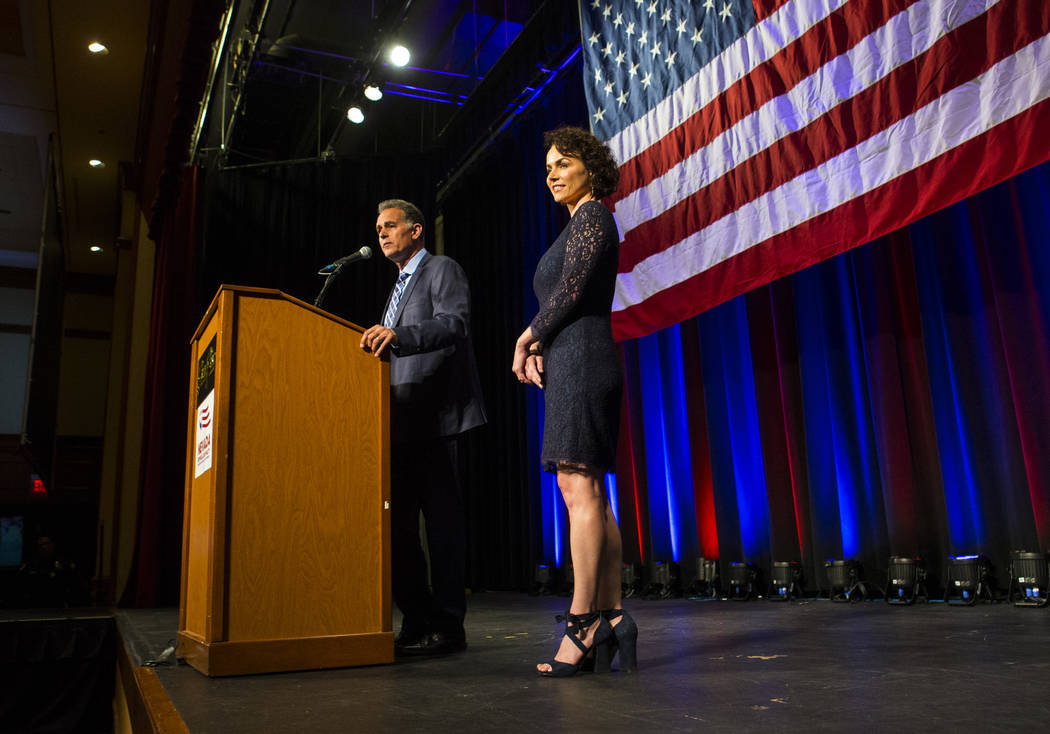 Amy Tarkanian looks on as her husband Danny Tarkanian, Republican candidate for the 3rd Congressional District, speaks after conceding to Democratic candidate Susie Lee during the Nevada Republica ...