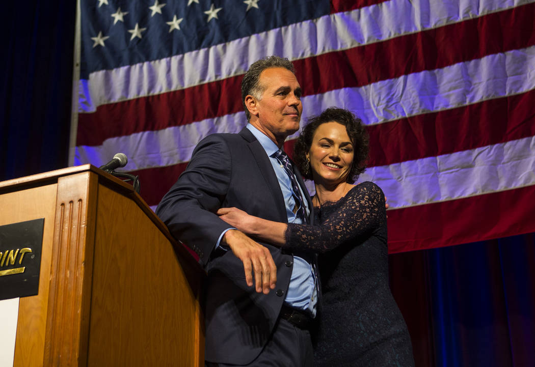 Amy Tarkanian comforts her husband Danny Tarkanian, Republican candidate for the 3rd Congressional District, after he conceded to Democratic candidate Susie Lee during the Nevada Republican Party ...