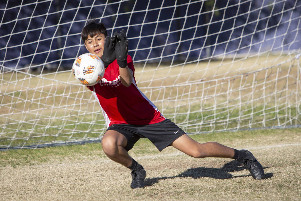 ff35a2c6c Durango s sophomore goalkeeper Jason Sotelo blocks a shot on goal during a  soccer practice at Durango