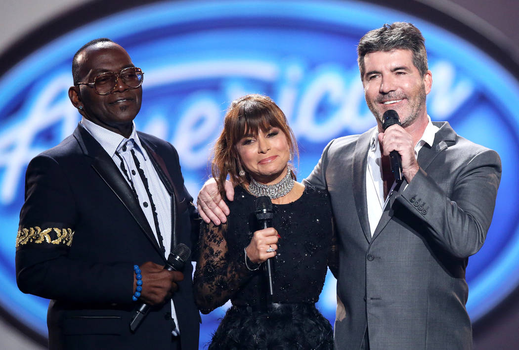 "FILE - In this April 7, 2016 file photo, former judges Randy Jackson, from left, Paula Abdul, and Simon Cowell appear at the ""American Idol"" farewell season finale in Los Angeles. The show is rec ..."