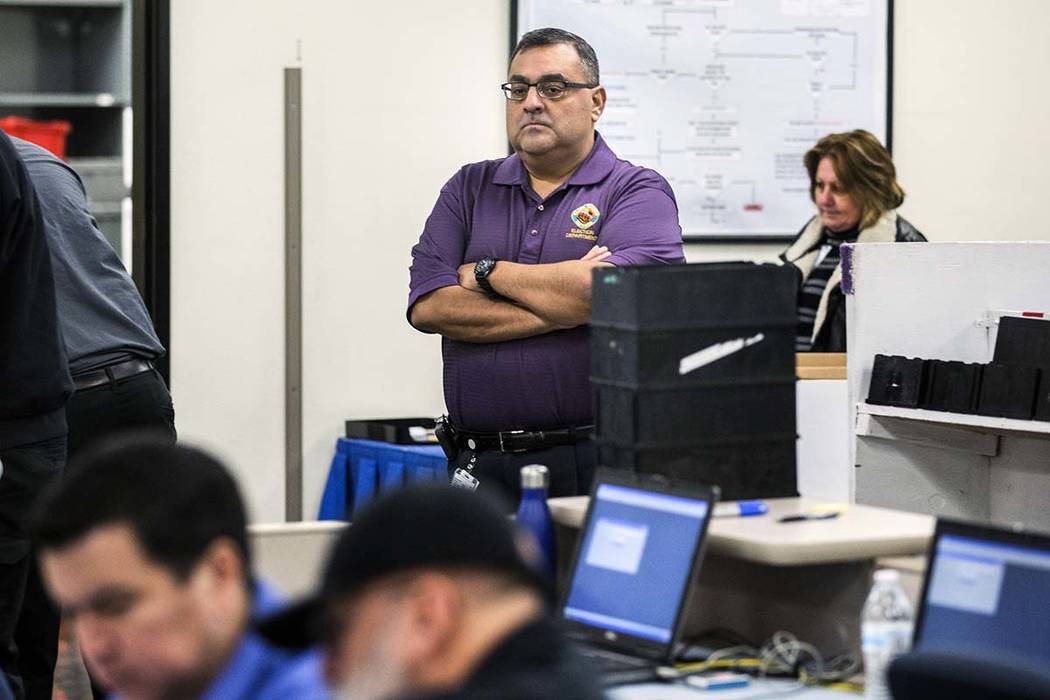 County Registrar of Voters Joe Gloria monitors activity during a voter recount at the Clark County Election Department office, 965 Trade Drive in North Las Vegas, on Monday, Dec. 5, 2016. Jeff Sch ...