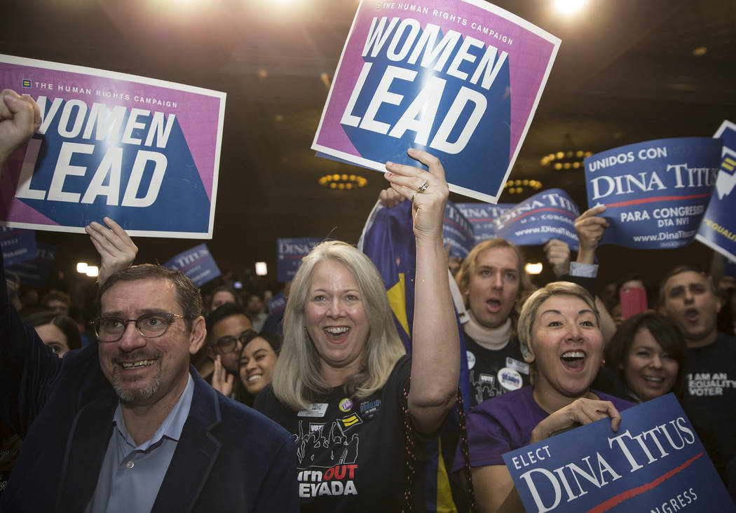 Rick Carrauthers, left, Kelly Smith and Penny James cheer as results come in for Congresswoman Jacky Rosen during an election night event hosted by the Nevada Democrats on Tuesday, November 6, 201 ...