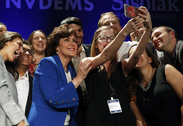 Rep. Jacky Rosen, D-Nev., in blue, poses for a selfie at a Democratic election night party after defeating Sen. Dean Heller, R-Nev., Wednesday, Nov. 7, 2018, in Las Vegas. A female political movem ...