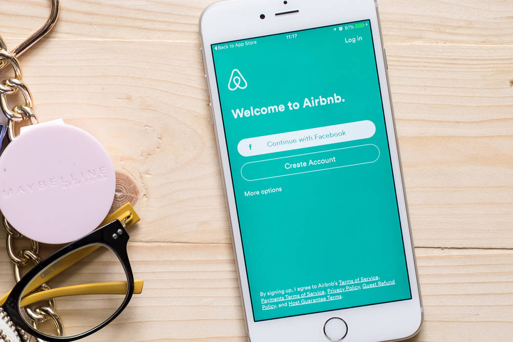 An iPhone is shown with with Airbnb application on the screen. (Getty Images)