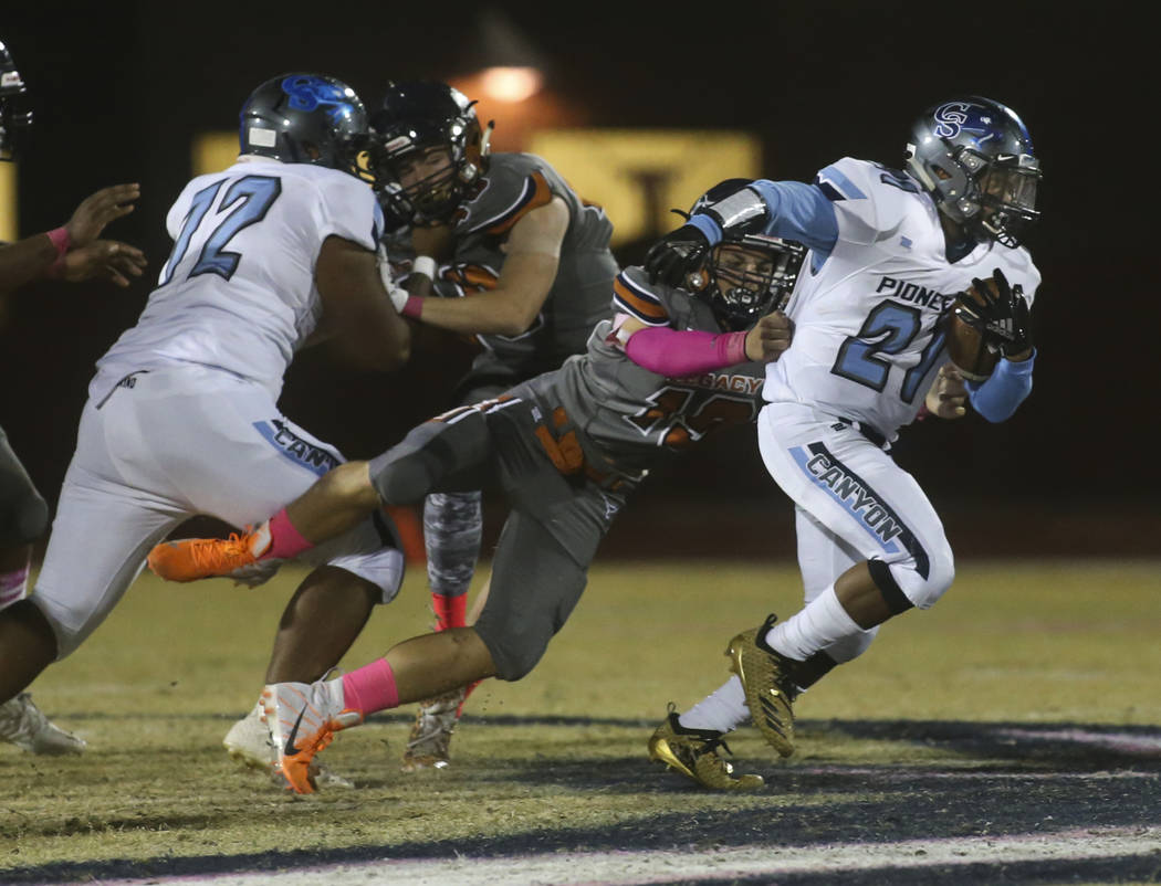 Legacy's Jason Burns (19) takes down Canyon Springs' Martin Blake (21) during the first half of a football game at Legacy High School in North Las Vegas on Thursday, Oct. 25, 2018. Chase Stevens L ...