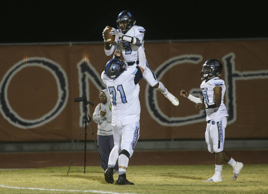 Canyon Springs' Jayvion Pugh (3) celebrates his touchdown with Canyon Springs' Trevor Moser (71) during the second half of a football game at Legacy High School in North Las Vegas on Thursday, Oct ...
