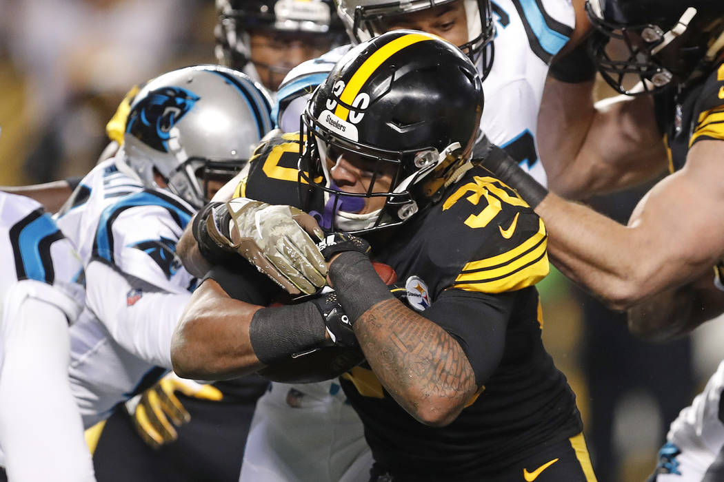 Pittsburgh Steelers running back James Conner (30) rushes for a touchdown during the first half of the team's NFL football game against the Carolina Panthers in Pittsburgh, Thursday, Nov. 8, 2018. ...