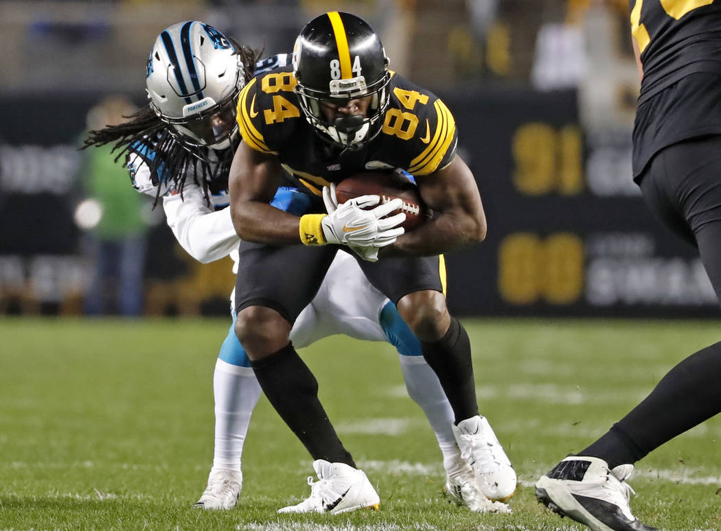 Pittsburgh Steelers wide receiver Antonio Brown (84) is tackled by Carolina Panthers cornerback Donte Jackson (26) during the first half of an NFL football game in Pittsburgh, Thursday, Nov. 8, 20 ...
