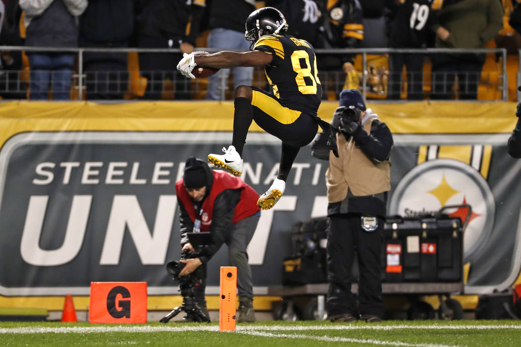 Pittsburgh Steelers wide receiver Antonio Brown (84) leaps over the goal line for a touchdown after catching a pass from quarterback Ben Roethlisberger during the first half of an NFL football gam ...