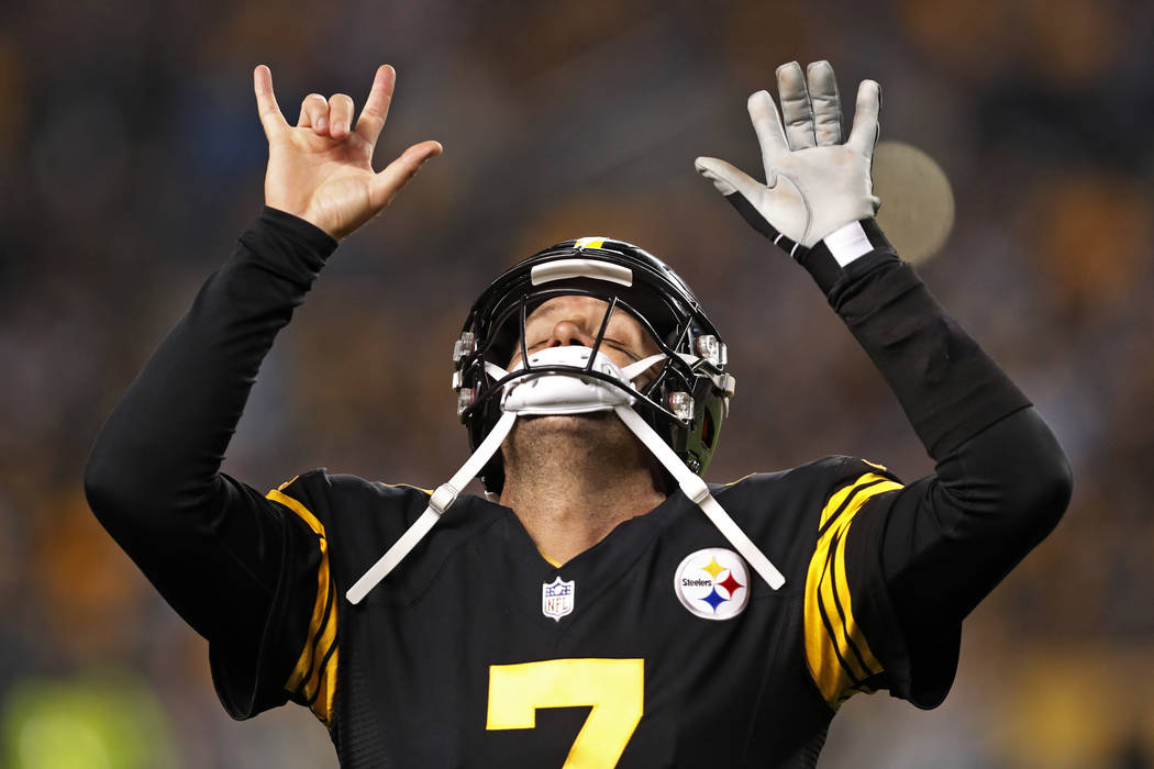 Pittsburgh Steelers quarterback Ben Roethlisberger (7) celebrates a touchdown pass to Antonio Brown during the first half of an NFL football game against the Carolina Panthers in Pittsburgh, Thurs ...
