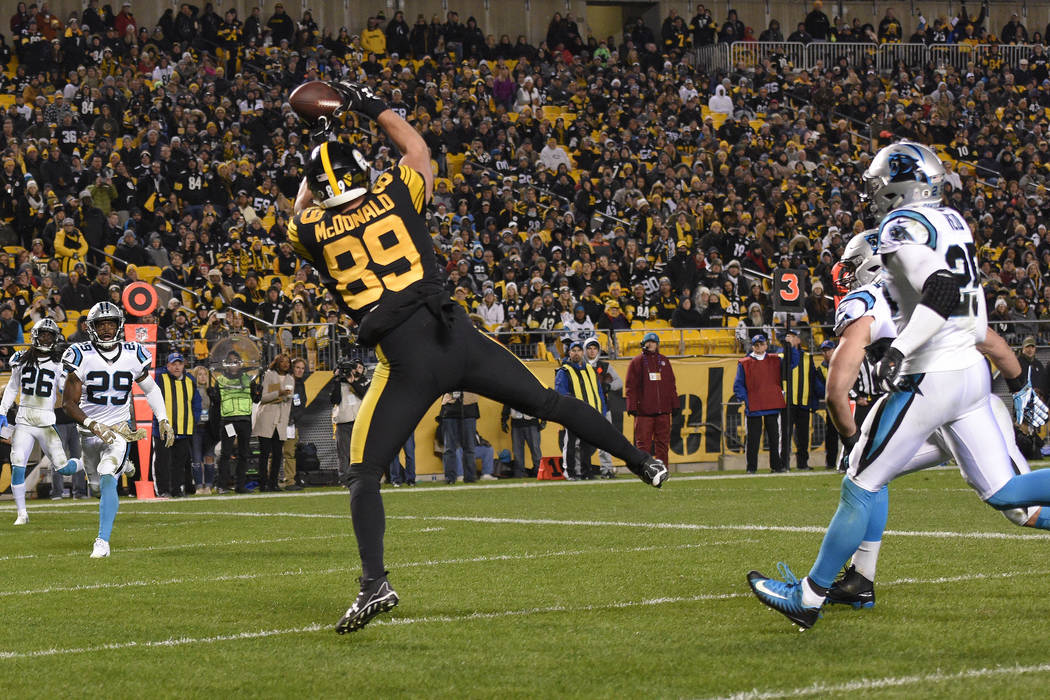 Pittsburgh Steelers tight end Vance McDonald (89) hauls in a pass from quarterback Ben Roethlisberger for a touchdown during the second half of an NFL football game against the Carolina Panthers i ...