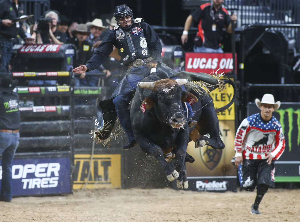 "Luciano De Castro rides ""Chiseled"" during the opening round of the of the Professional Bull Riders World Finals at T-Mobile Arena in Las Vegas on Wednesday, Nov. 7, 2018. Chase Stevens L ..."