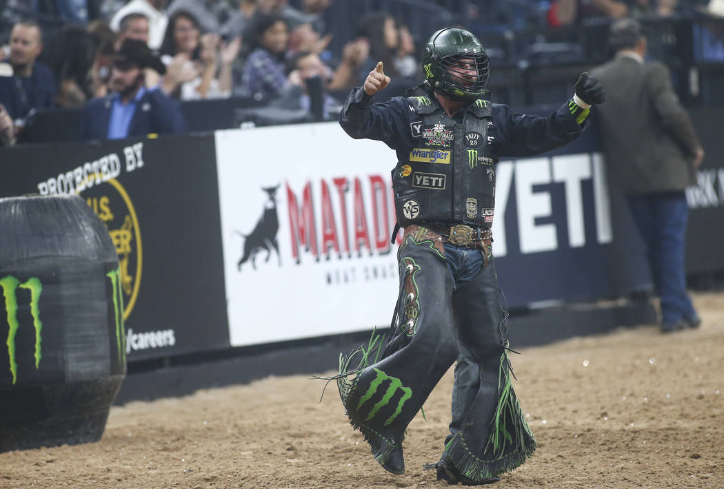 "Chase Outlaw celebrates his ride on ""AMS 40B"" during the opening round of the of the Professional Bull Riders World Finals at T-Mobile Arena in Las Vegas on Wednesday, Nov. 7, 2018. Chas ..."