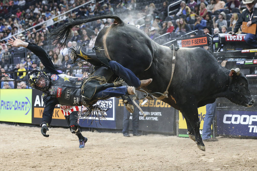 "Cody Teel gets bucked off of ""Fearless"" during the opening round of the of the Professional Bull Riders World Finals at T-Mobile Arena in Las Vegas on Wednesday, Nov. 7, 2018. Chase Stev ..."