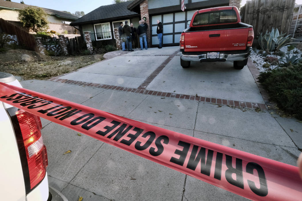 Ventura County Sheriff's deputies stand outside the house of shooting suspect David Ian Long in Newbury Park, Calif., on Thursday, Nov. 8, 2018. Authorities said the former Marine opened fire at a ...