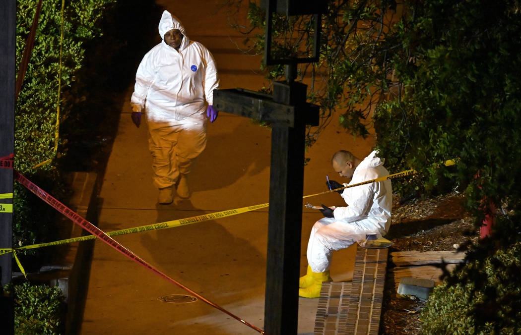 """A forensics team works the scene Thursday, Nov. 8, 2018, in Thousand Oaks, Calif.,where a gunman opened fire Wednesday inside a country dance bar crowded with hundreds of people on """"college n ..."""