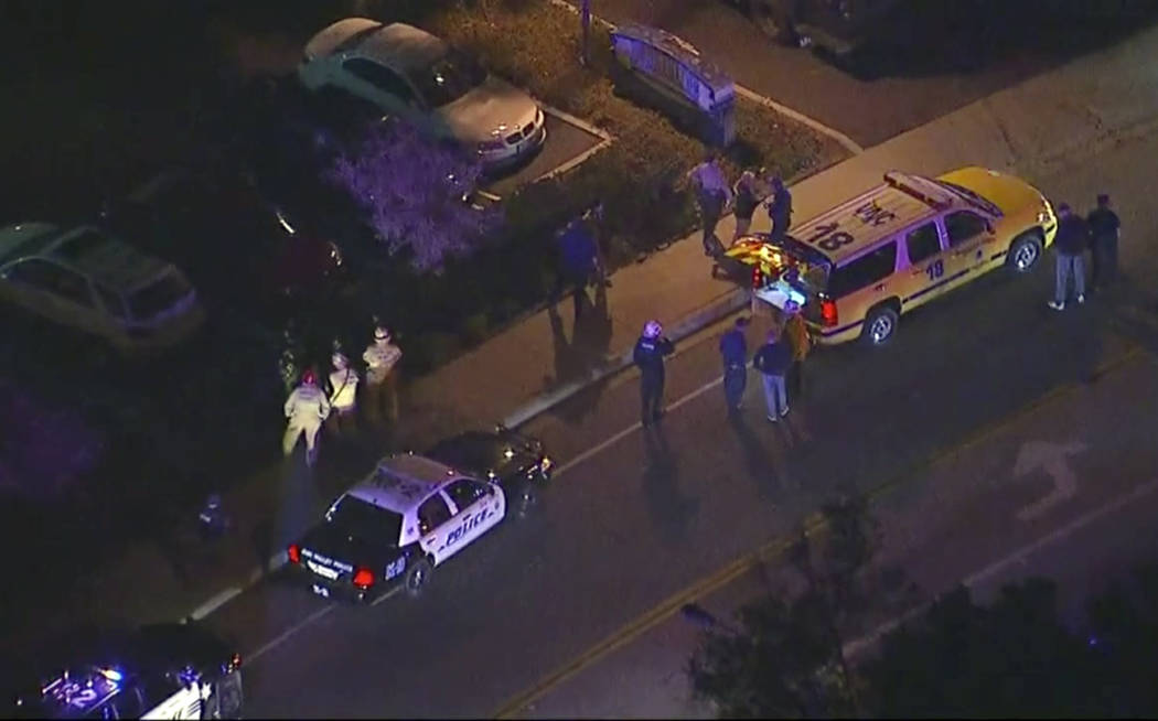 In this image made from aerial video, police vehicles line a road in the vicinity of a shooting in Thousand Oaks, California, early Thursday, Nov. 8, 2018. Authorities say there were multiple inju ...