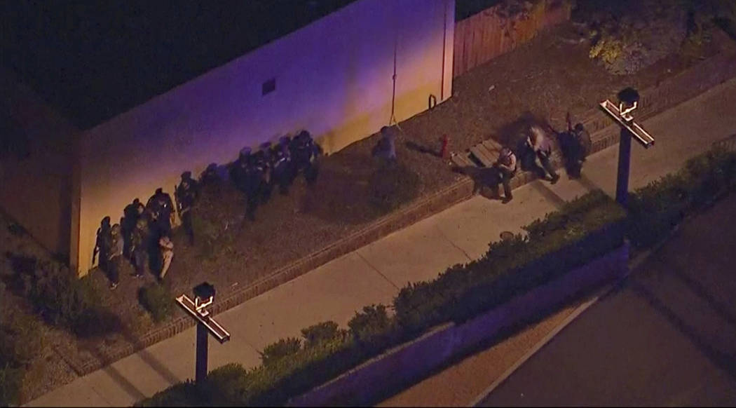 In this image made from aerial video, police move through the vicinity of a shooting in Thousand Oaks, California, early Thursday, Nov. 8, 2018. Authorities say there were multiple injuries - incl ...