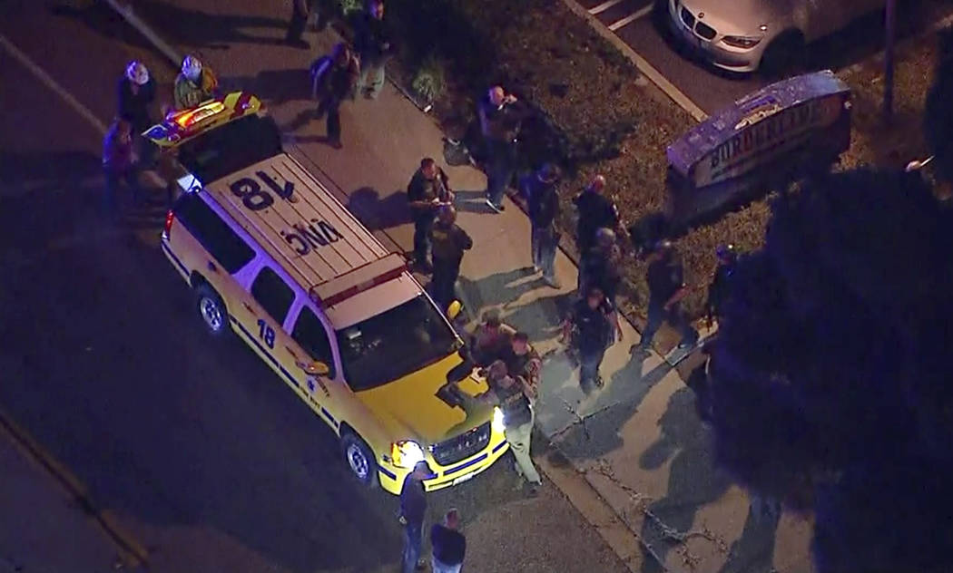 This image made from aerial video show officers around a Police SUV in the vicinity of a shooting in Thousand Oaks, California, early Thursday, Nov. 8, 2018. Authorities say there were multiple in ...