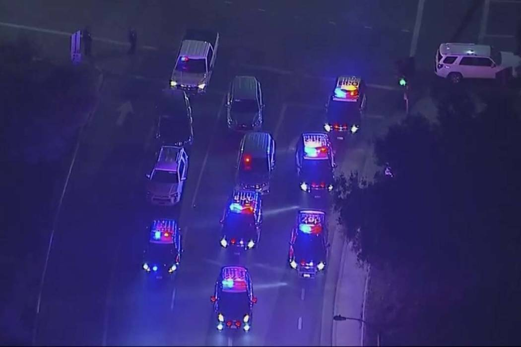 In this image made from aerial video, police vehicles block an intersection in the vicinity of a shooting in Thousand Oaks, California, early Thursday, Nov. 8, 2018. Authorities say there were mu ...