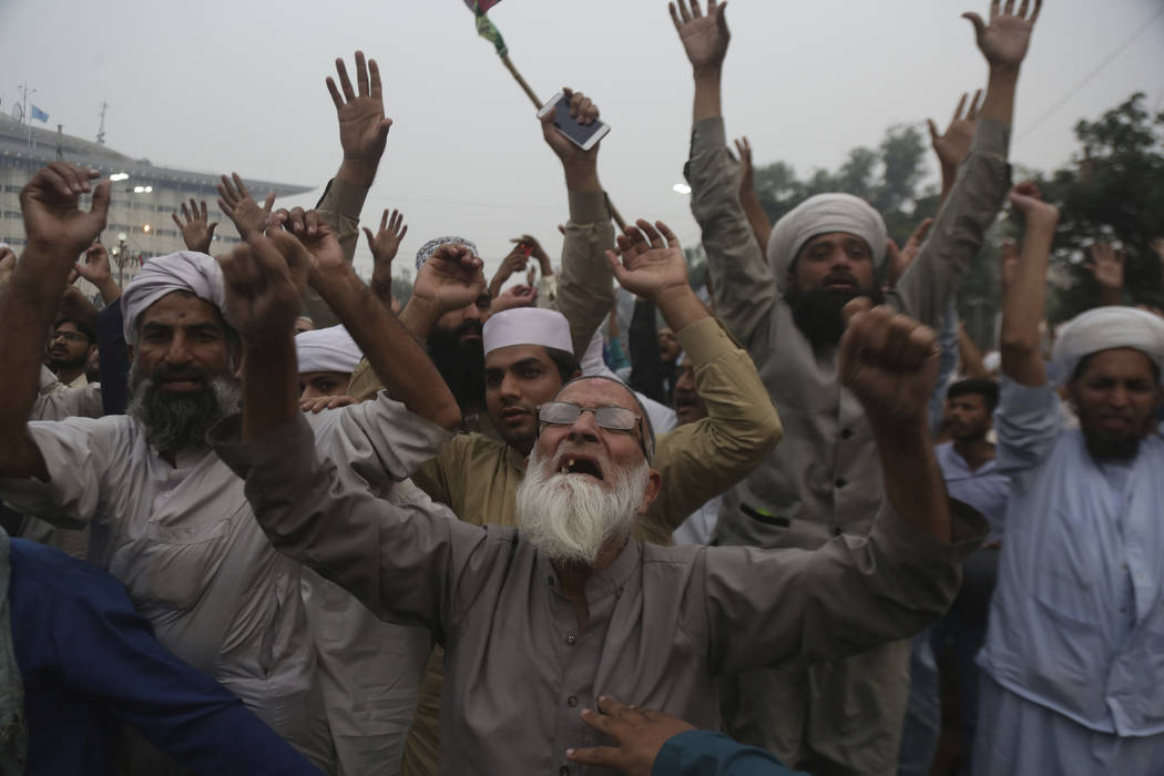 Protesters shout slogans during a rally to condemn a Supreme Court decision that acquitted Asia Bibi, a Christian woman, who spent eight years on death row accused of blasphemy, in Lahore, Pakista ...