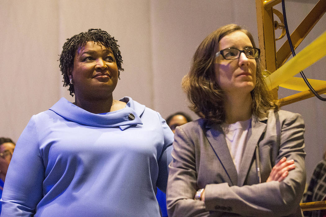 Georgia gubernatorial candidate Stacey Abrams, left, stands with her campaign manager, Lauren Groh-Wargo, before speaking to her supporters during an election night watch party at the Hyatt Regenc ...