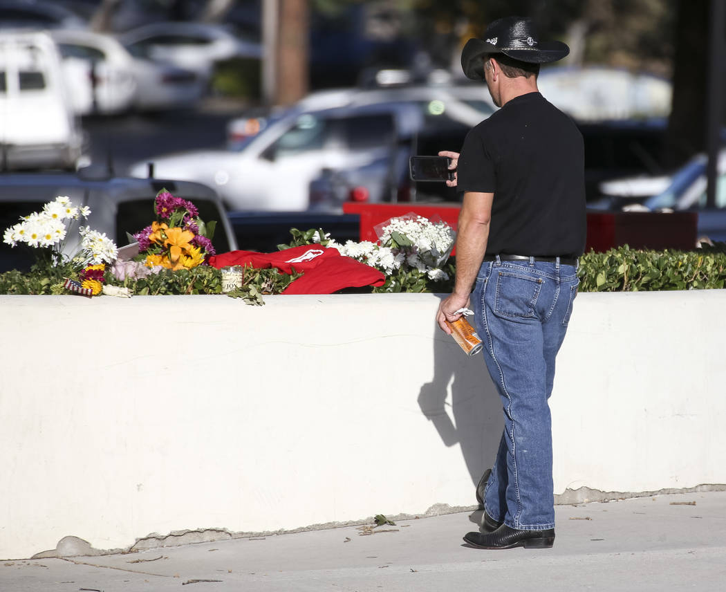 A man takes a photo of items at a memorial for victims of the Borderline Bar and Grill mass shooting in Thousand Oaks, Calif., on Thursday, Nov. 8, 2018. Richard Brian Las Vegas Review-Journal @ve ...