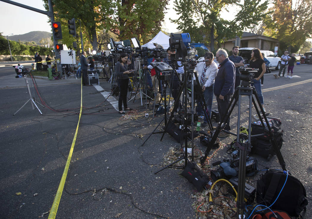Members of the media gather near the site of the Borderline Bar and Grill mass shooting in Thousand Oaks, Calif., on Thursday, Nov. 8, 2018. Richard Brian Las Vegas Review-Journal @vegasphotograph