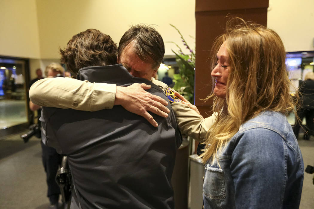 Thousand Oaks Chief of Police Tim Hagel, center, is consoled by city residents Jim Friedl, left, and Christina Duffy during a candlelight vigil for victims of the Borderline Bar and Grill mass sho ...