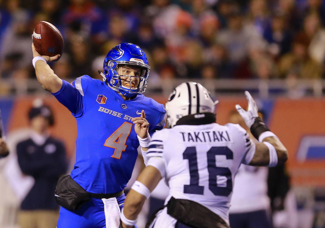 Boise State quarterback Brett Rypien (4) looks to throw down field as BYU linebacker Sione Takitaki (16) puts pressure on in the second half of an NCAA college football game, Saturday, Nov. 3, 201 ...