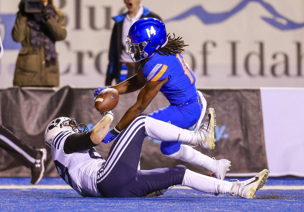 Boise State cornerback Tyler Horton (14) strips the ball away from BYU tight end Matt Bushman (89) in the second half of an NCAA college football game, Saturday, Nov. 3, 2018, in Boise, Idaho. Hor ...