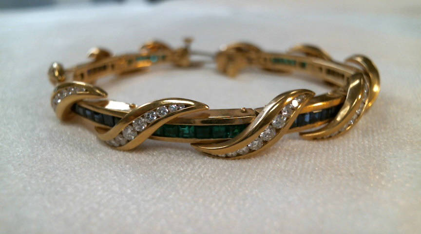 18k yellow gold fancy link bracelet with 10 alternating channel set square blue sapphire and square emerald links with each set with six gemstones except the clasp link which has five sapphires (3 ...